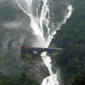 Train Passes Under The Beautiful Waterfall – South Goa