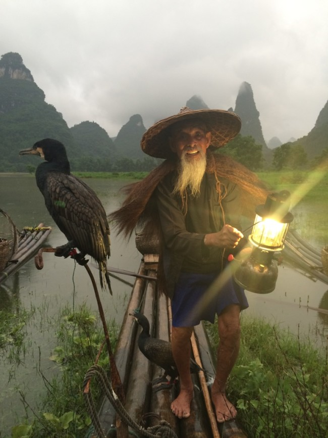 A cormorant fisherman on the Li River outside of Guilin, China
