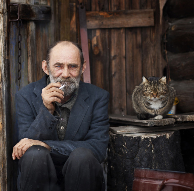 An old man with his cat