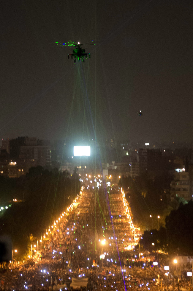 Egyptians shine laser pointers at military helicopter in protest