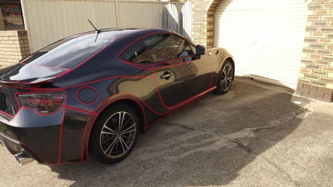 Guy puts reflective vinyl tape on the panels of his car to make a Tron Car. Truly amazing.