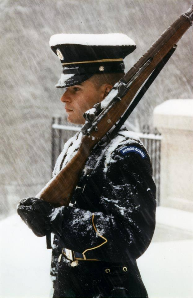 Solemn guard at the Tomb of the Unknown Soldier still on duty even when the government