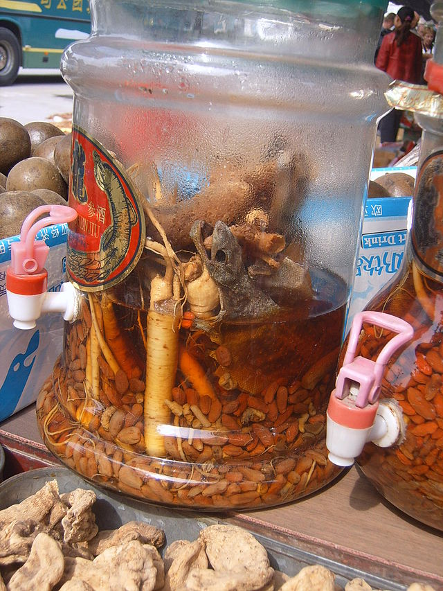 Traditional Chinese Medicinal Juice. Note the gecko's apparent disintegration as it enters the liquid.