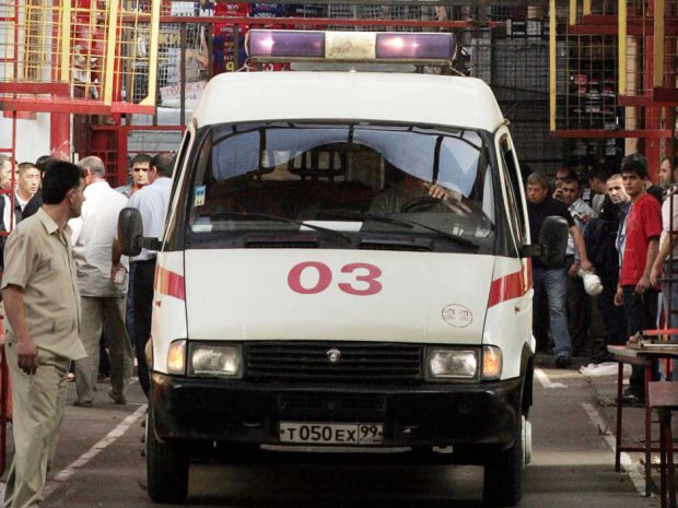 An ambulance leaves the site of explosio