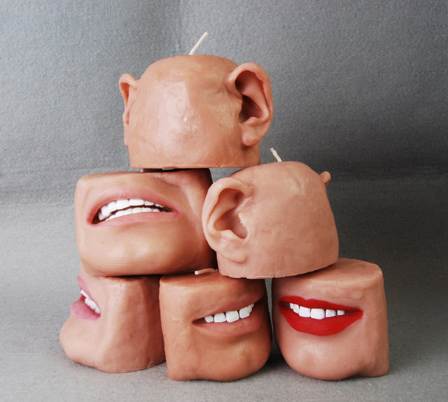 Candles that are made to look like mouths and ears