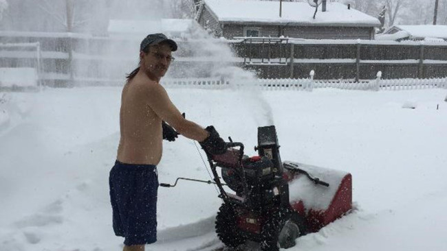 Nothin' says Indiana more than snowblowin' twelve inches of snow with your skivvies on while rockin' a rad mullet and sunglasses.