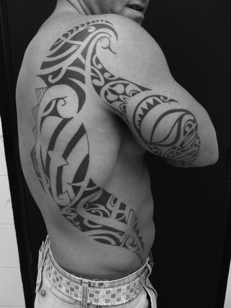 Tribal tattoos that inspire for Side back tattoo