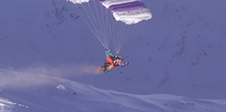 Flying Snowmobile: Crazy Guy With A Parachute And Snowmobile