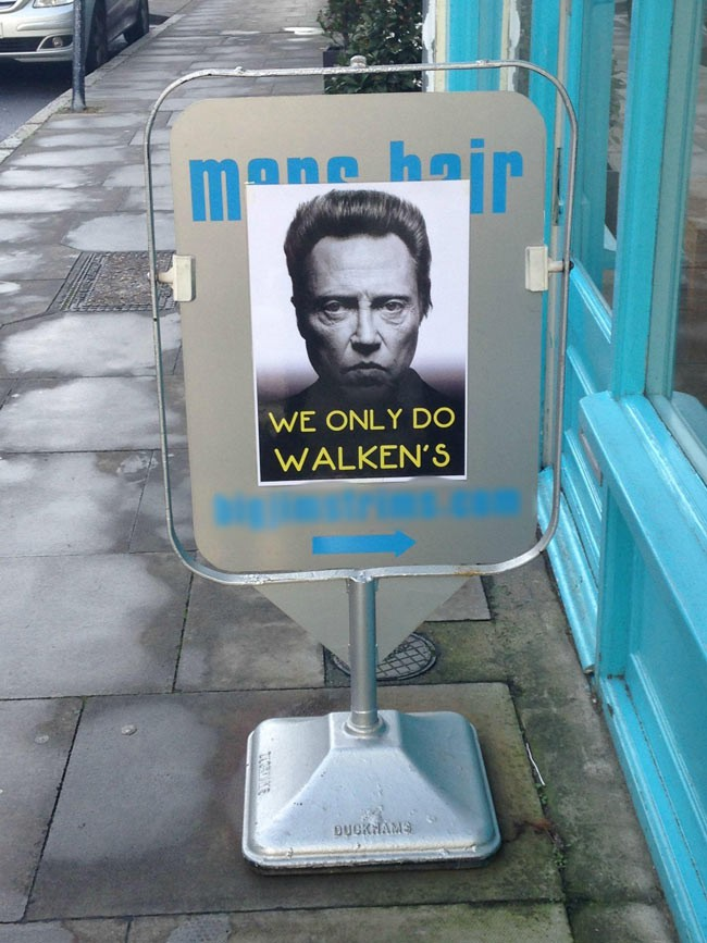 A sign outside a local barbers.