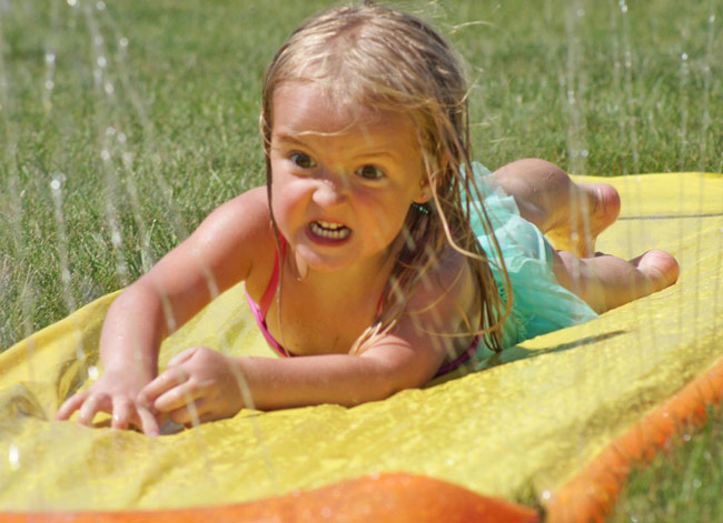 My boyfriend's niece is taking this slip n' slide thing way too seriously.