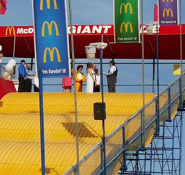 Saw a couple get married, on top of a giant slide, sponsored by McDonalds and witnessed by Ronald McDonald.