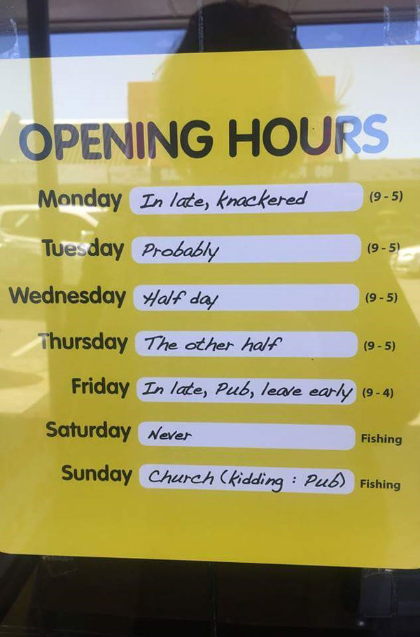 Honest opening times sign