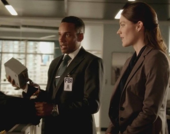 """We collected his hard drives"" FBI agent from Limitless TV series holds up PC power supply"