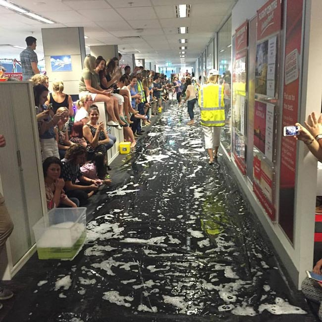 My office said 'f*ck it' (again) this year, the slip 'n slide Christmas party is back!
