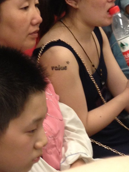 Finally, an Asian with a random English word tattoo on them