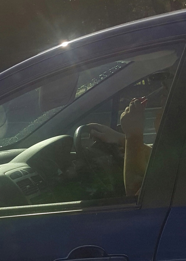 Darwin awards contender .. (driving 80km/h with a pair of full sized scissors cutting his nose hairs)