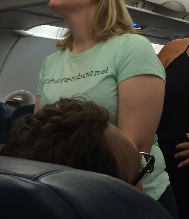 Her shirt says #Heavenbound. One of the last shirts you want to see on your flight