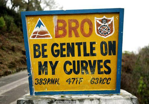This is an actual highway sign in Bhutan