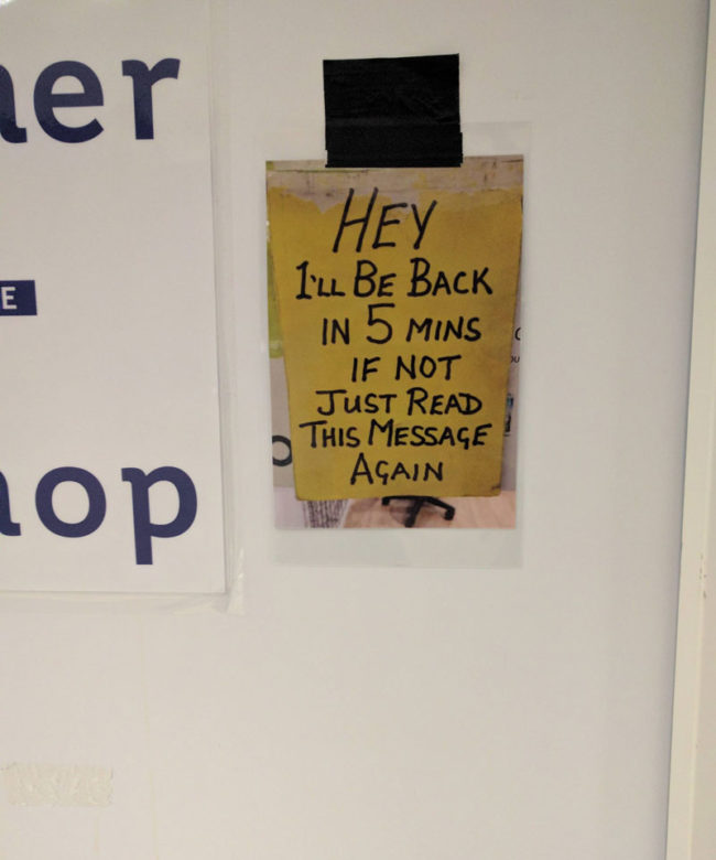 Sign on the door of the company mailroom