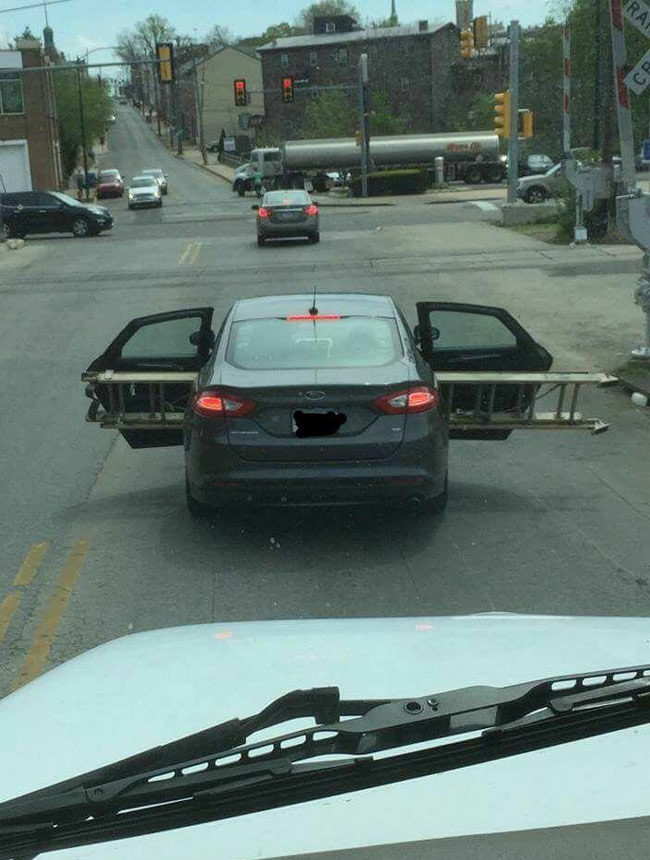 Transporting a ladder in the back seat of a sedan. Love me some Norristown, PA