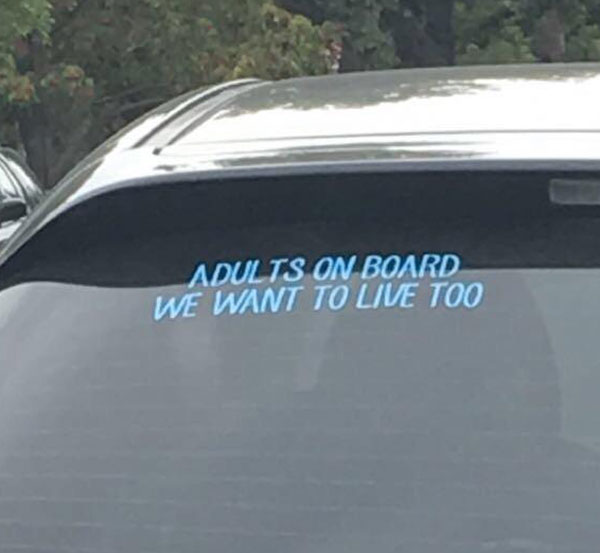 Saw this on the car in front of us...