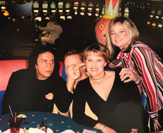 My Dad once ran into Gene Simmons of KISS in Las Vegas and asked him if he could get a photo taken wit my parents. He said sure, and as soon as the photo was taken, Gene stuck his finger in my mom's ear while also covering up my Dad's face