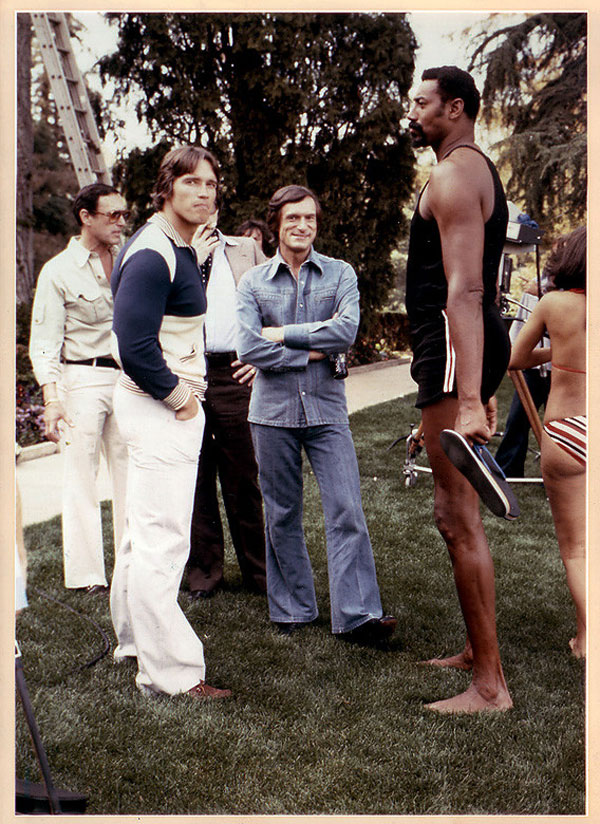 Hugh Hefner, Wilt Chamberlain, and Arnold Schwarzenegger at the Playboy Mansion in 1977