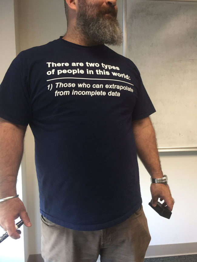 Students were asking this professor why his shirt is missing the 2nd part