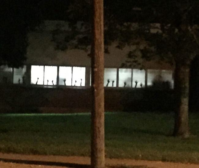 Kindergarten teacher had students trace their hands for the window...creepier than intended