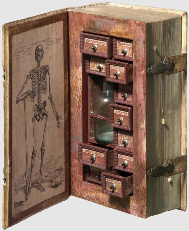 17th century assassins poison cabinet disguised as a book
