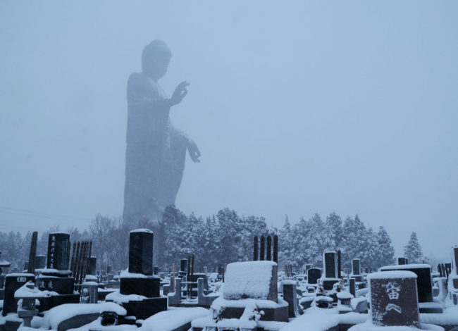 Ushiku Daibutsu in Japan, one of the tallest statues in the world, as seen in this winter landscape