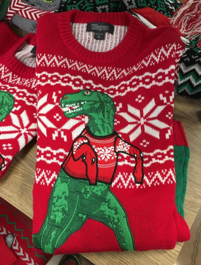 The dangling sleeves on this T-Rex Christmas sweater