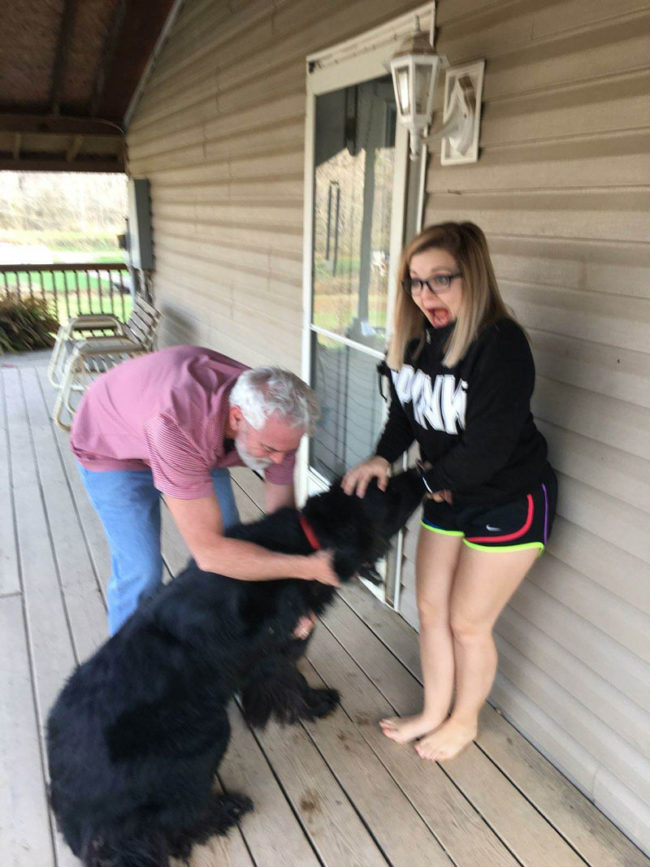"I took my 4'10"" tall girlfriend to my family's Thanksgiving this year and she met their very friendly Newfoundland"
