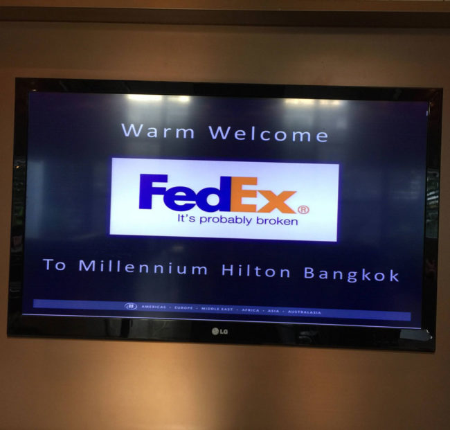 """We need to show we're sponsored by FedEx."" ""No prob. I'll grab something off the Internet."" Seen at the Millennium Hilton, Bangkok"