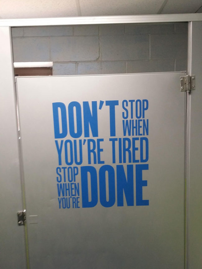 Motivational bathroom stall door
