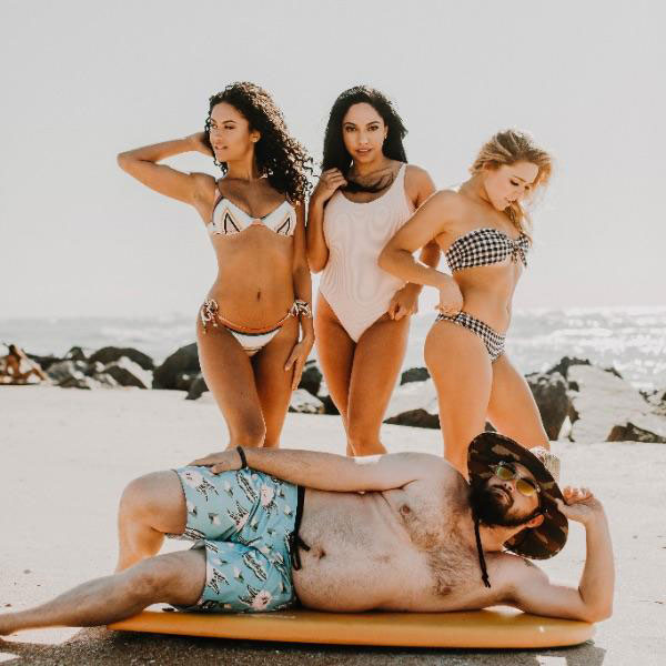 Our magazine does a swim suit issue once a year featuring models who submit applications online. We had a new submission this year that really caught our eye..