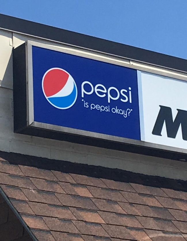 This Pepsi sign on a convenience store