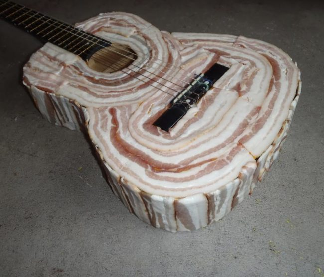 Is this Kevin Bacon's guitar or Kevin's bacon guitar
