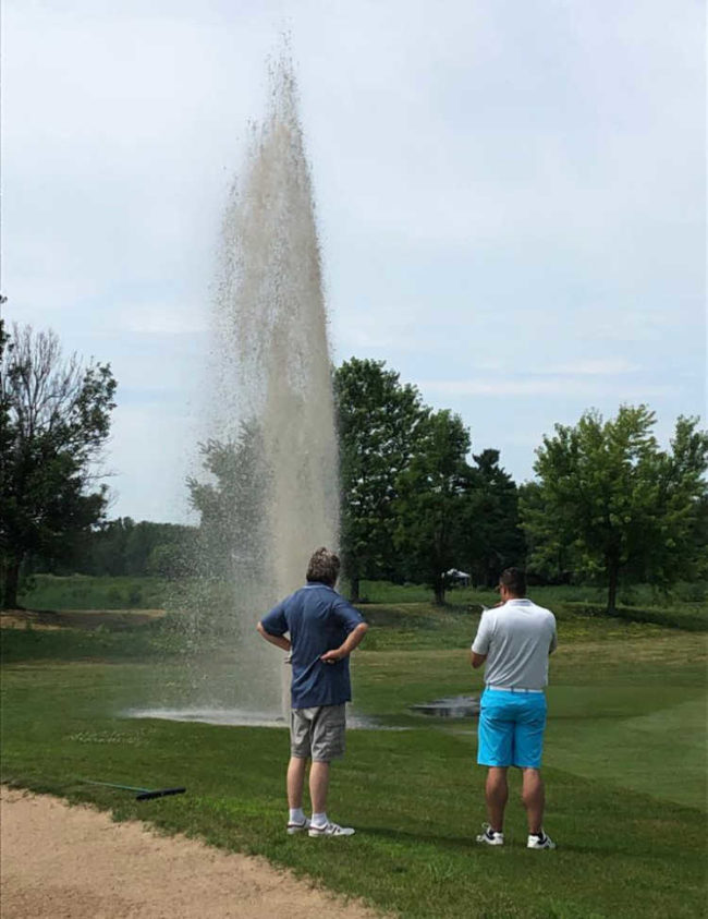 My Dad hit a sprinkler dead on with one of his drives today at a local golf tournament. He's in the blue shirt