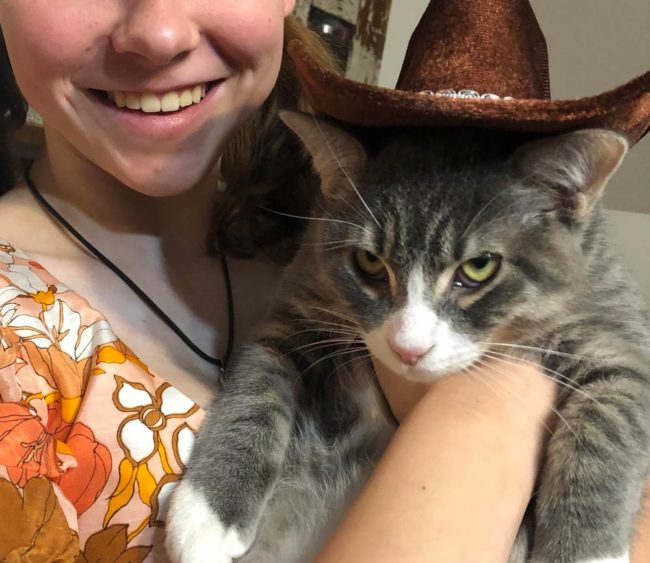 My daughter bought the cat a new hat at Goodwill. He's so excited