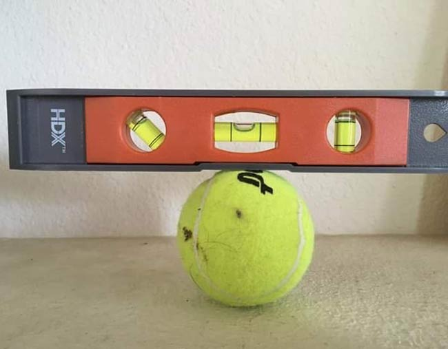 Tennis companies are lying! Tennis balls are flat!