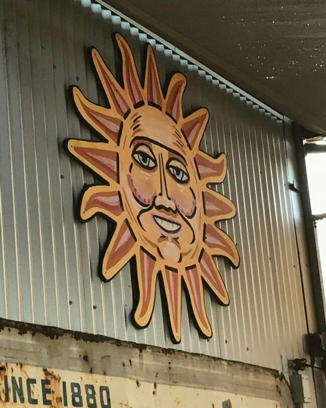 Is it me, or does this sun decoration look like it's about to steal the Declaration of Independence
