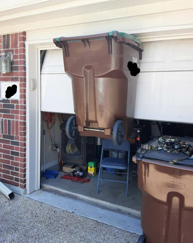 We were opening the garage door and the handle caught the trash can