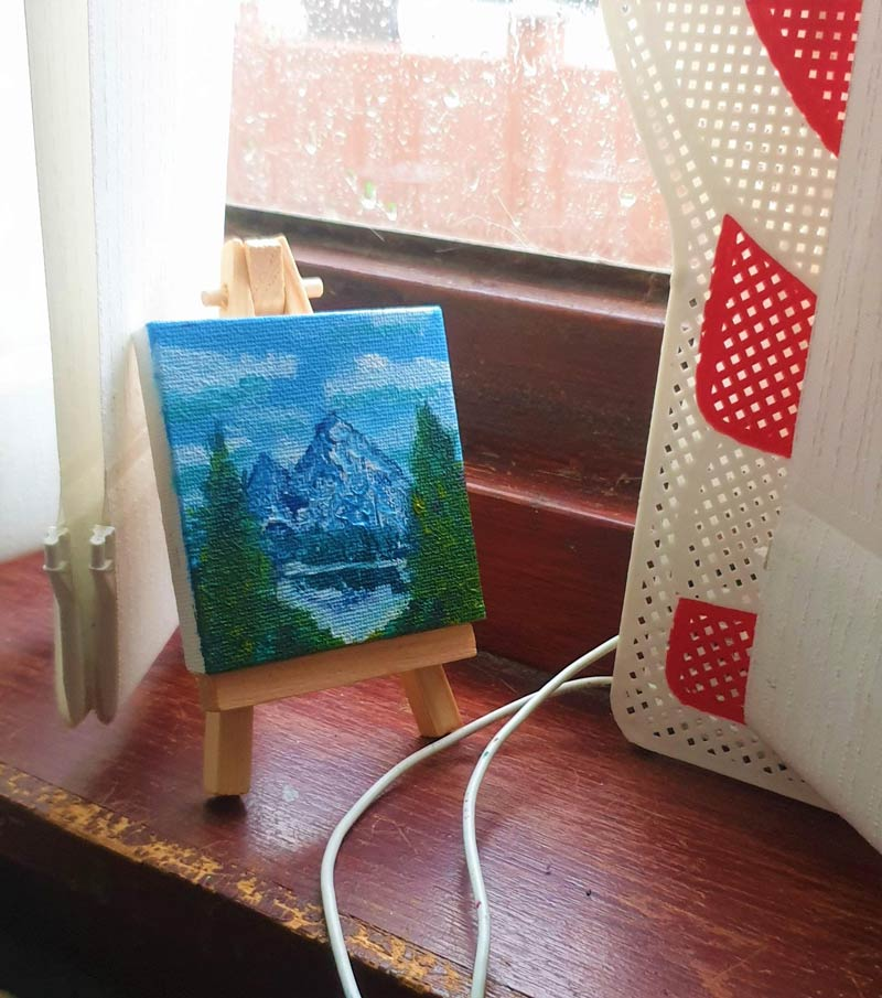 I received a tiny canvas and easel for Christmas and thought the only appropriate thing to paint was Bob Ross