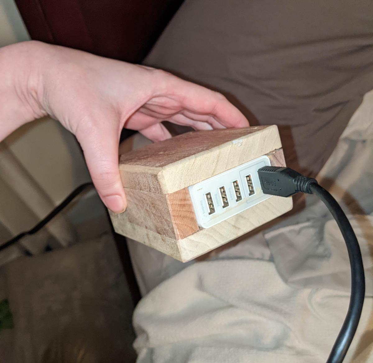 My dad spends his spare time building wooden boxes for charging ports, but hey, if he's happy..